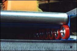 Each end of the roller sits on a Palletflo wheel.
