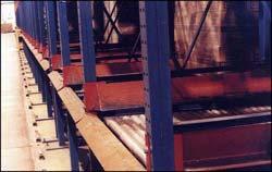 Here you can see the pallet entry guides that help forklift operators load pallets onto the gravity roller conveyor.