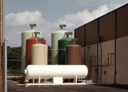 These are bulk chemical storage tanks. Click to enlarge.