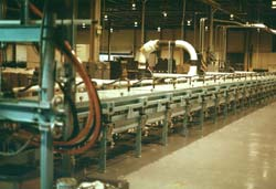 Kornylak manufactures the Process Tunnel using a patented Fluid Film Processing to produce foam core panels. Click to enlarge.