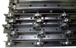 A group of pallet rail guides. Pallet rail guides help the pallet maintain a center position as it glides down Palletflo gravity flow rails.