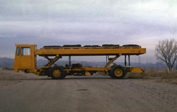 The Karry-All low-lift cargo truck is an automated cargo system that can transport 7 1/2-tons loads.