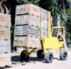Straddle Fork is a crate transporting crop mover for harvesting and transporting tree and row crops from orchard or field fast and with minimum amount of manual labor. Straddle Fork is a forklift specialty vehicle.