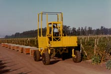 Straddle Fork® quickly picks up full bin and easily drives over empty or partially full bins.