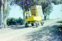 Straddle Fork is a crop harvesting bin transporter with features similar to a forklift.